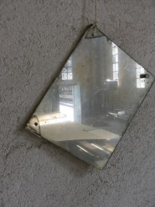 A picture of a cloudy mirror on the wall